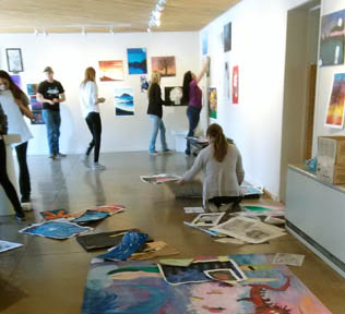Students hanging art show 1-fb