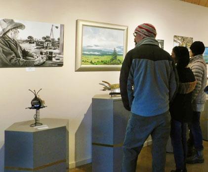 guests in background looking at art